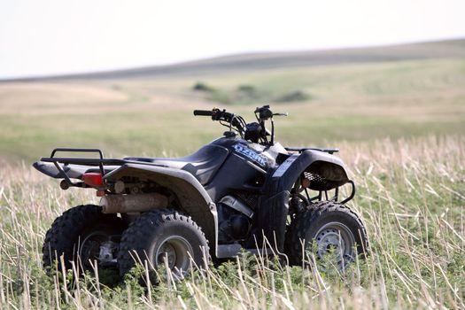 All terrain vehicle parked in Saskatchewan field