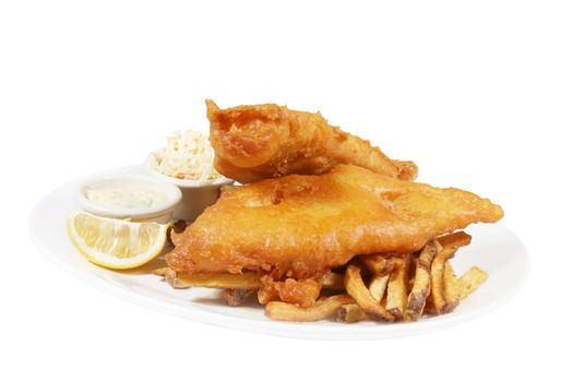 isolated plate of fish and chips with tarter sauce and coleslaw