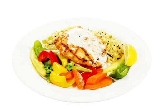 isolated grilled salmon with cream dill sauce on a plate with veggies and rice