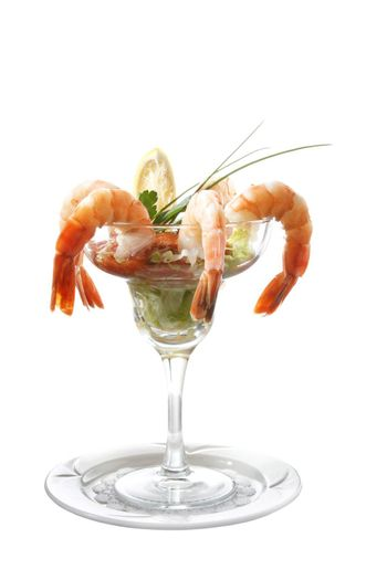 isolated cooked shrimp in a cocktail glass
