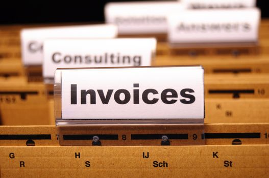 invoice or invoices concept with business folder in office showing paperwork