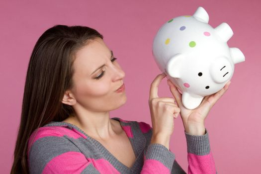 Young woman holding piggy bank