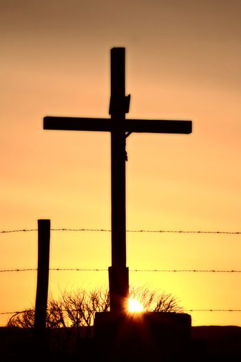 Christ on the cross at sunset