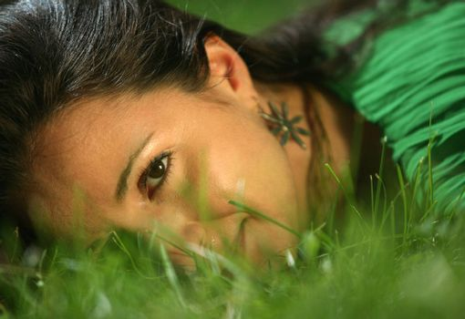 The girl in a grass. The face close-up