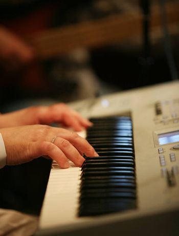 The man plays on an electric piano