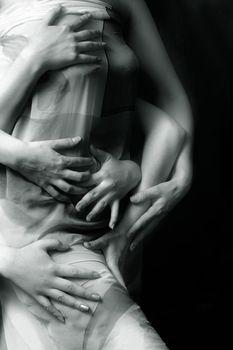 Three pairs female hands on a female body. b/w+blue tone