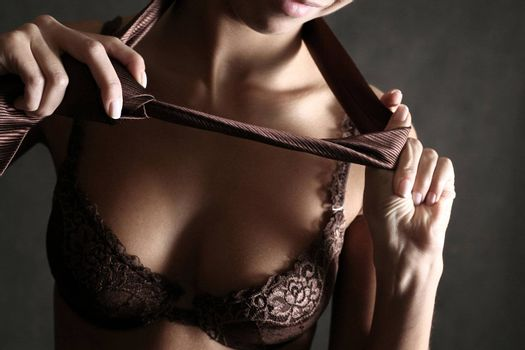 The girl removes a brown tie