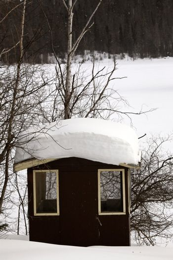 roof of shelter packed with snow