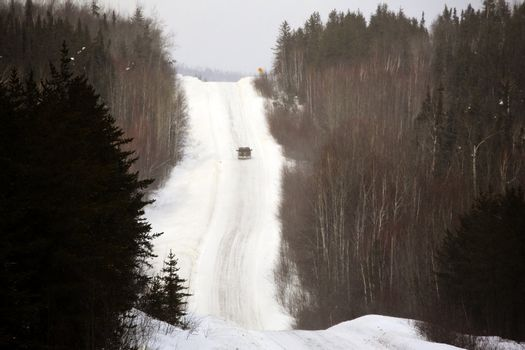 approaching vehicle on logging road in winter