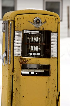 Old gasoline pump in winter