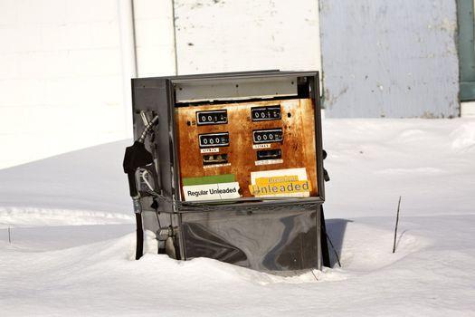 An old gasoline pump in winter