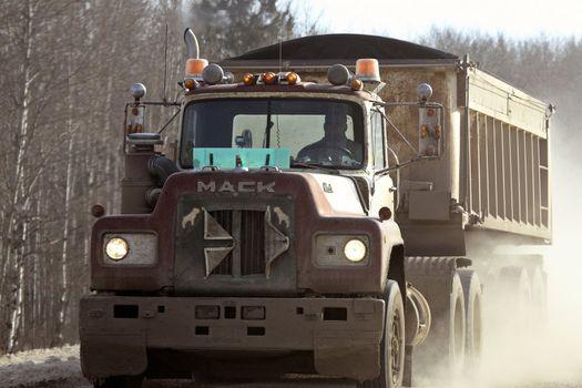 approaching truck on narrow road in winter