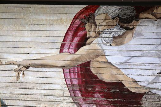 Religious mural on side of garage