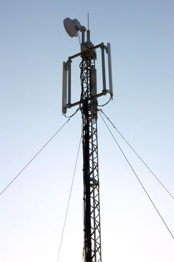 Aerial mobile communication  against the blue sky on a sunset