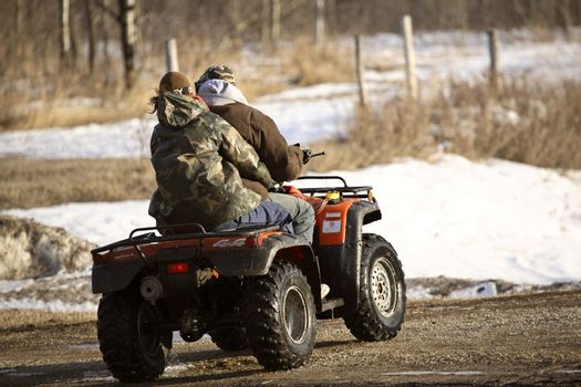 Riders on all terrain vehicles in spring