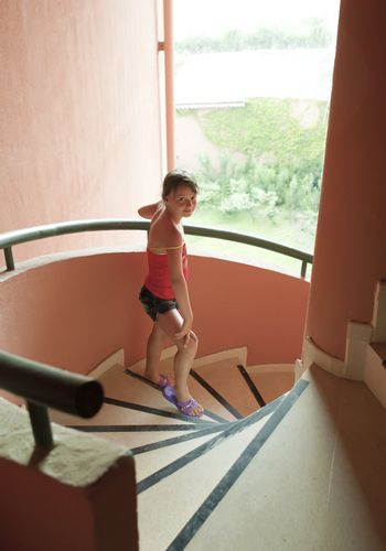 Portrait of a beautiful young girl on  staircase