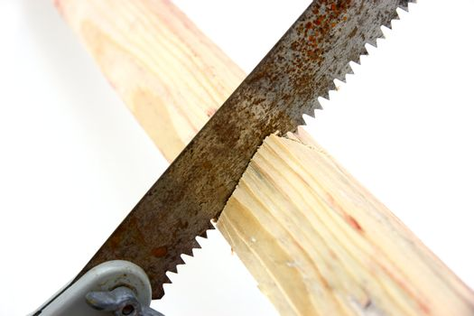 Hacksaw in sawed yellow wooden