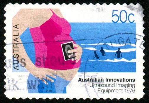 AUSTRALIA - CIRCA 2004: stamp printed by Australia, shows expectant mother , circa 2004
