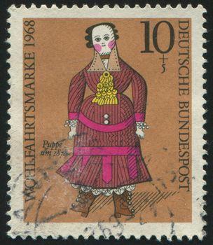 GERMANY- CIRCA 1968: stamp printed by Germany, shows doll, circa 1968.