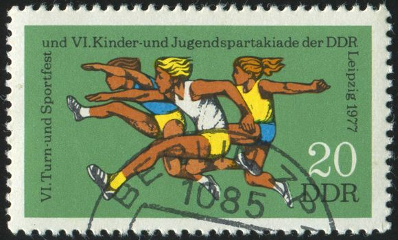 GERMANY- CIRCA 1977: stamp printed by Germany, shows Hurdles, girls, circa 1977.