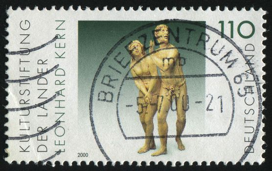 GERMANY- CIRCA 2000: stamp printed by Germany, shows The Expulsion from Paradise, sculpture by Leonhard Kern, circa 2000