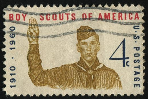 UNITED STATES - CIRCA 1960: stamp printed by United states, shows  Boy scout Giving scout sign, circa 1960