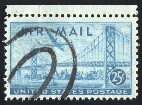 UNITED STATES - CIRCA 1947: stamp printed by United states, shows Plane over San Francisco-Oakland Bay Bridge, circa 1947