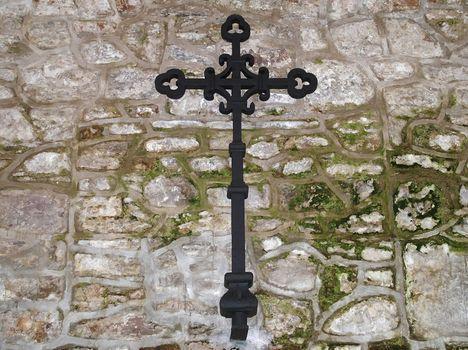 iron cross on church wall