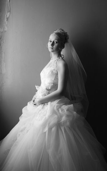 Beautiful bride in dress with flowers. b/w