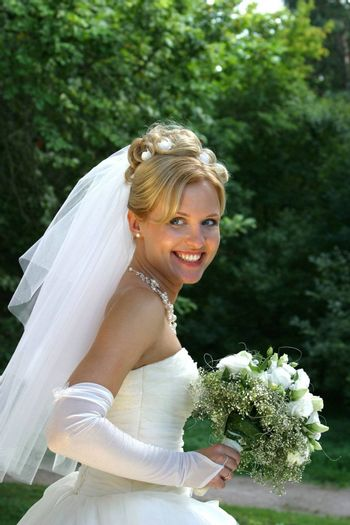 The beautiful bride with a bouquet