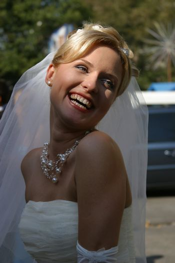 Beautiful smiles of the bride of the blonde. The happy Bride.