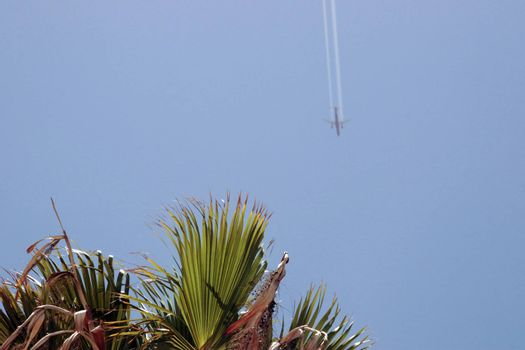 plane in flight leaving a carbon trail