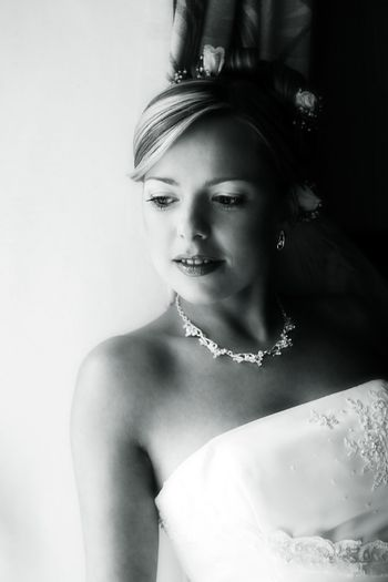 Portrait of the smiling beautiful bride. b/w+blue tone