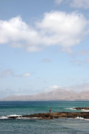 a view of a man fishing in lanzarote