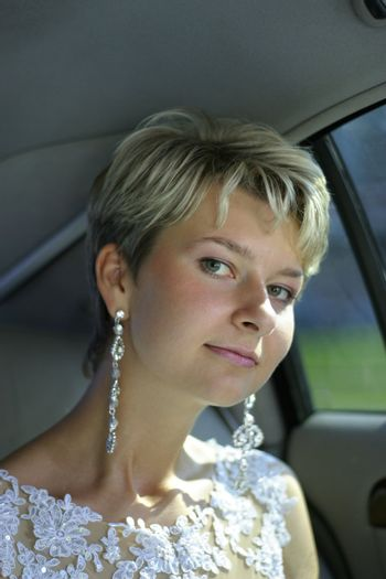 Portrait of the beautiful bride in the car