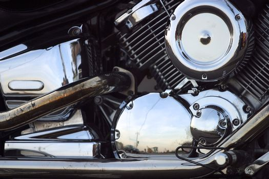 Part of a motorcycle with reflections