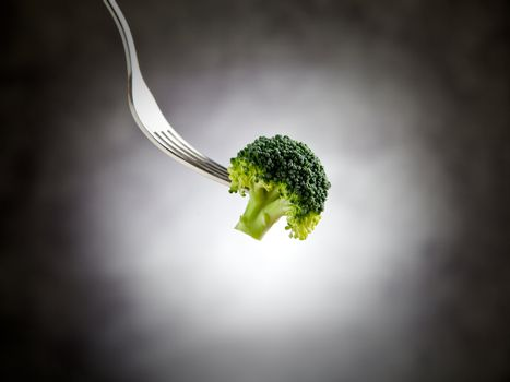 Fork is holding broccoli