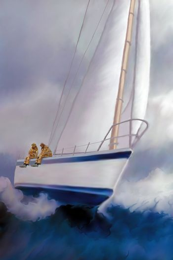 Two sailors enjoy the excitement of rough seas and the ride of a sailboat heeling over.