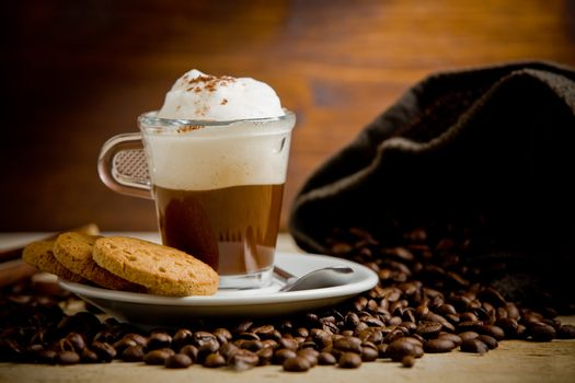 Cappuccino on coffee beans
