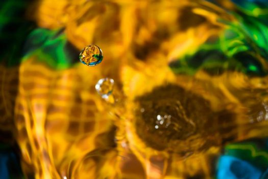 Macro photography of colorful water drop collision sculpture.