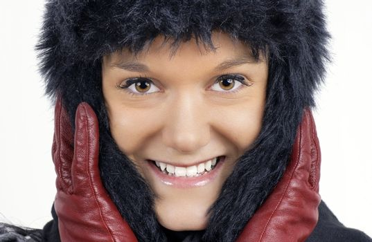 Young woman in black furry winter hat