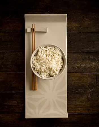 Rice with asian chopstick