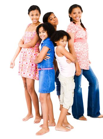Girls standing with teenage girls and smiling isolated over white
