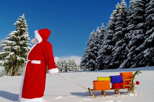 Santa Claus, Father Christmas with colorful presents on a sledge