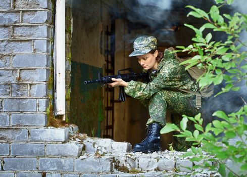Woman with a rifle, keep defense in the battle