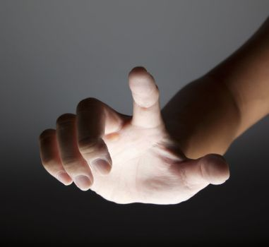 hand touching in the dark