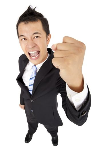 happy and excited businessman with fist