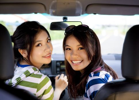 happy girls in the car and enjoy driving