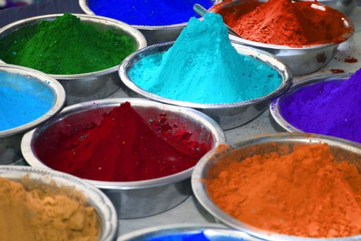 Colorful powder in bowls for the celebration of holi festival, in India.