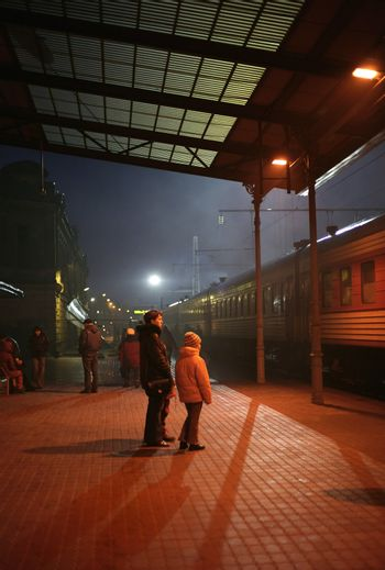 The image of station with people at night